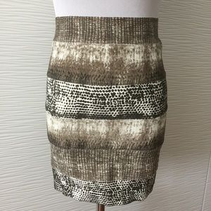 Bebe Three Patterned body con skirt